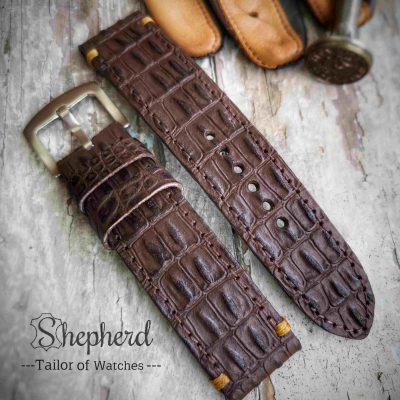 Embossed strap 604
